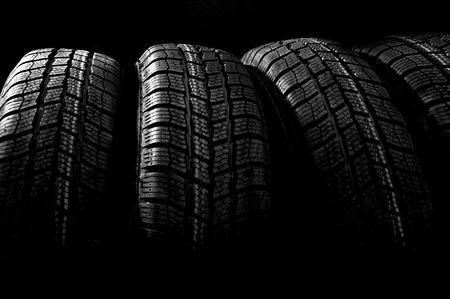 Dark background with winter car tires photo