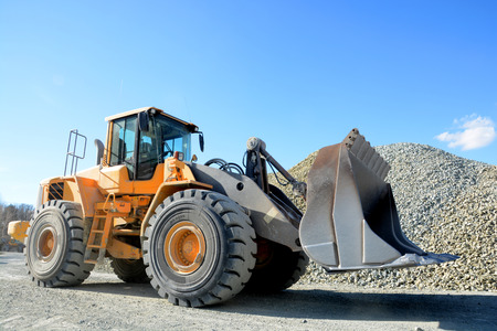 big yellow mining truck in quarry
