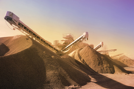 Heavy machinery of gravel production in quarry. Vintage retro effect photo
