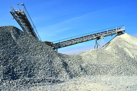 Heavy machinery of gravel production in quarry. photo