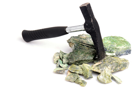 geological: Hammer and serpentynite isolated on white background
