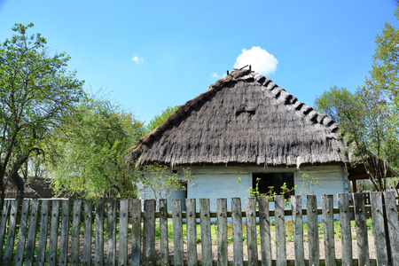 lubelskie: LUBLIN, POLAND - APRIL 27: Old house with thatch roof in the open-air museum of lubelskie district on april 27, 2015 in Lublin, Poland.