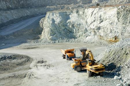 sand quarry: Big yellow trucks in quarry