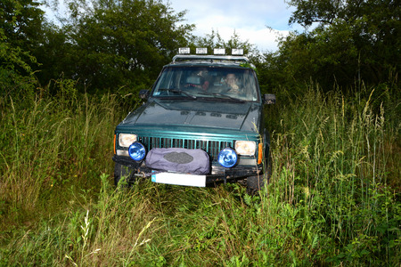 4wd: 4x4 offroad truck on meadow Stock Photo
