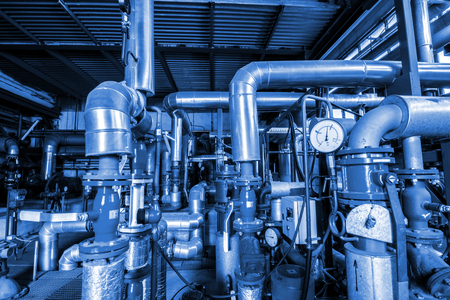 power plant: Equipment, cables and piping as found inside of a thermal power station. Stock Photo