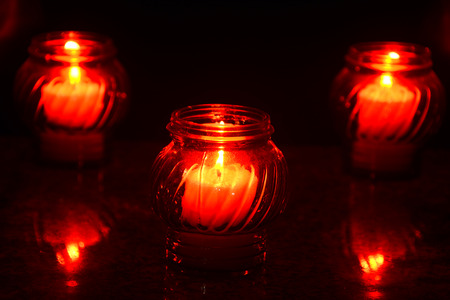 christian halloween: Candles Burning At a Cemetery During All Saints Day. Shallow depth of field. Stock Photo