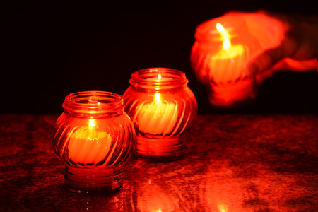 saints: Candles Burning At a Cemetery During All Saints Day. Shallow depth of field. Stock Photo
