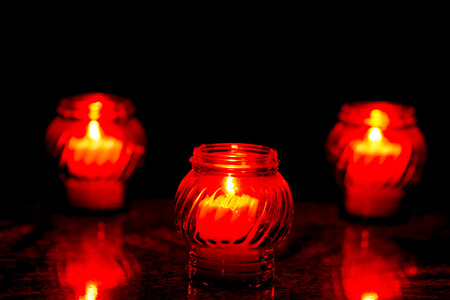 Candles Burning At a Cemetery During All Saints Day. Shallow depth of field. Stock Photo