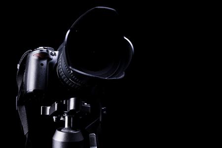 dslr: Professional DSLR camera on black  background.