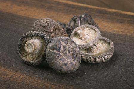 shiitake: Shiitake mushrooms on old wooden table