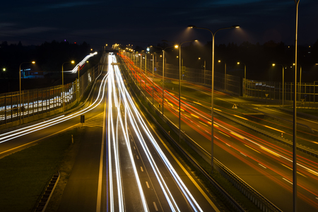 highway lights: Car lights on a highway at night Stock Photo