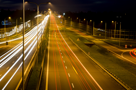 motorway: Car lights on a highway at night Stock Photo