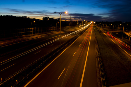 city road: Car lights on a highway at night Stock Photo