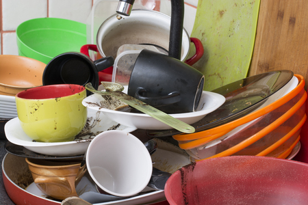 sink: Pile of dirty dishes in the sink