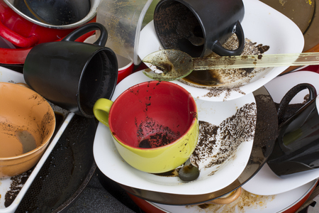 dirty: Pile of dirty dishes in the sink