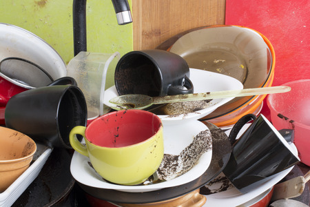 unwashed: Pile of dirty dishes in the sink