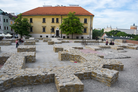 LUBLIN, POLAND - JUNE 02, 2016. The Po Farze Square with reconstructed foundations of the former temple, and royal castle in background on June 02, 2016 in Lublin, Poland