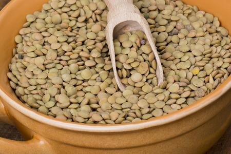 Lentil in bowl on wooden table