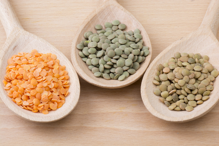 Three kinds of lentil on spoons