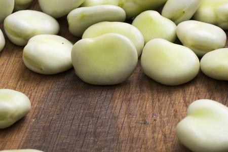 Fresh broad beans on wooden board Zdjęcie Seryjne