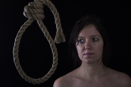 gallows: A young caucasian woman hanging suicide.