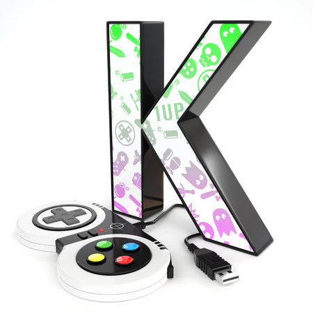 Green and purple video game icons painted over K 3d letter with video game controller Reklamní fotografie