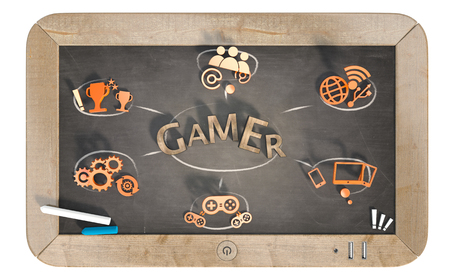 gamer word with 3D icons on slate chalkboard
