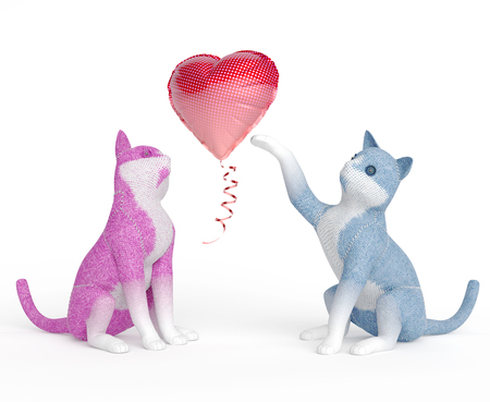 puppet cats playing with inflatable balloon shaped as a heart Stock fotó