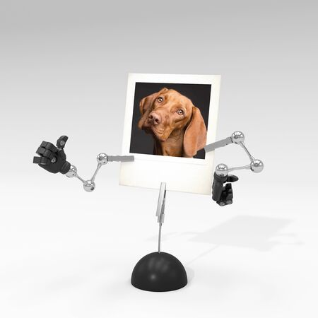 photo of a dog on picture clip holder with articulated arms clipped on it, giving the dog a thumb up attitude.