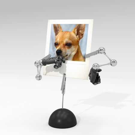 photo of a dog on picture clip holder with articulated arms clipped on it, giving the dog a process of thinking attitude. Stock fotó - 131810844