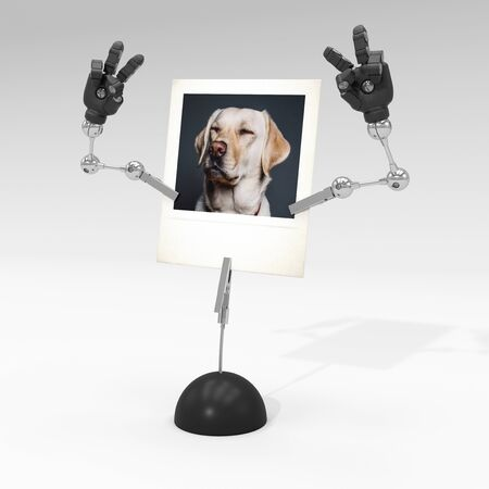 photo of a dog on picture clip holder with articulated arms clipped on it, giving the dog a victorious attitude. Stock fotó - 131811860