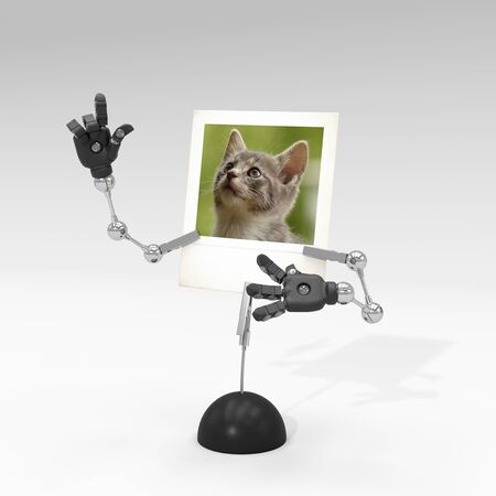 photo of a cat on picture clip holder with articulated arms clipped on it, giving the cat a funny attitude.