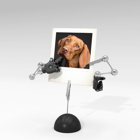 photo of a dog on picture clip holder with articulated arms clipped on it, giving the dog a funny attitude.