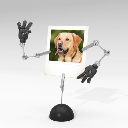 photo of a dog on picture clip holder with articulated arms clipped on it, making the dog waving at someone. Stock fotó - 131811009