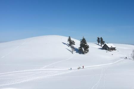 Winter landscape on mount Dobratsch near Villach, Austria with centered hut Editorial