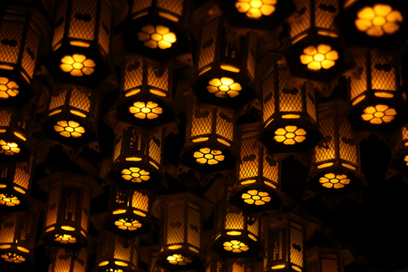 Close view of lit lanters outside a temple on Koyasan mountain, Japan at night