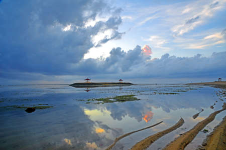 Sun rise at Sanur beach in Bali Indonesia during low tide.