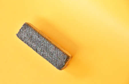 Chalk Eraser in used condition isolated on yellow background