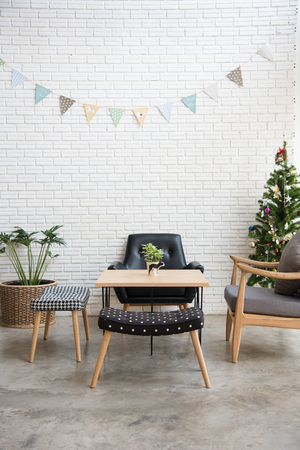 cozy sofa corner with christmas tree decoration at the back. sofa is in modern style and made with wood. Reklamní fotografie
