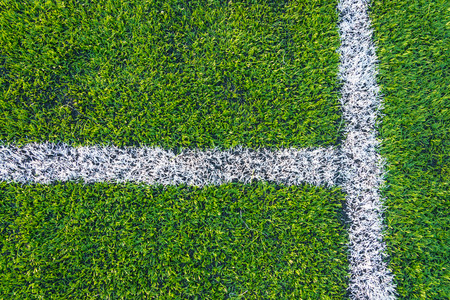 soccer field: A top down angle view of white line on a green soccer field.