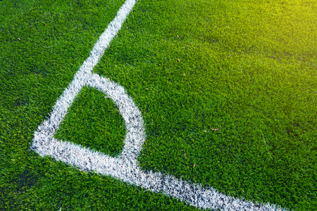 A top down angle view of white line on a green soccer field.  Image ID:496085251 Reklamní fotografie