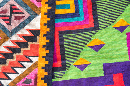 Close up peruvian fabric souvenir's pattern. The souvenir is handmade with colorful dyed wool. Reklamní fotografie