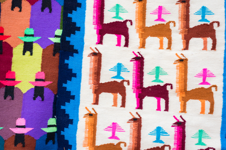 Close up peruvian fabric souvenir's of alpaca and donkey pattern. The souvenir is handmade with colorful dyed wool.