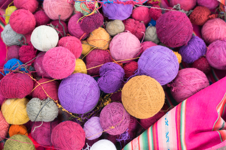 colorful wool or yarn balls in pink and purple for handcraft hobby