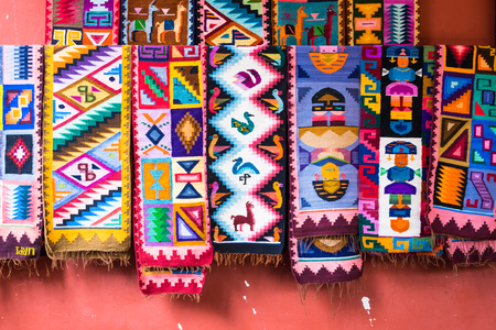 Colorful handmade peruvian blanket in different shapes made by wool selling in the market for tourists as souvenir products Reklamní fotografie
