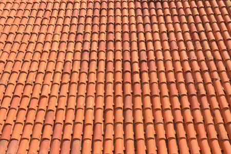 A pattern of tiles made by clay for house of building roof top in orange color. Reklamní fotografie