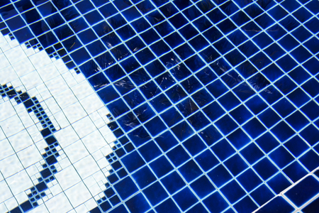 blue mosaic tiles in swimming pool under sunlight