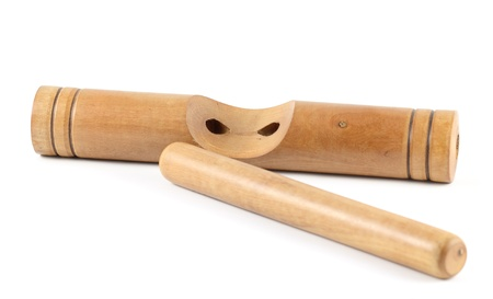Wooden claves isolated on a white background.