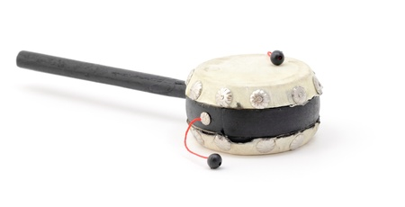 A dumplin drum (twisting hand drum) isolated on a white background. photo