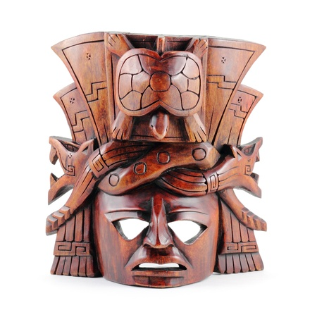 Hand-carved wooden Mayan mask isolated on a white background.
